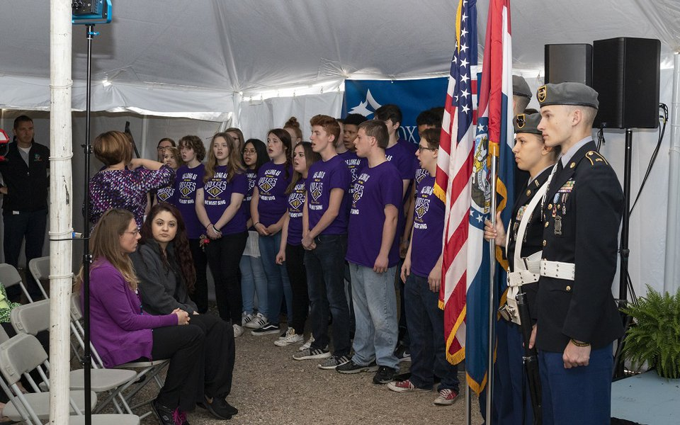 The Monett High School Choir sings at the ceremony