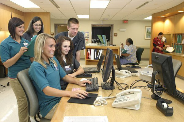 Group of cox health employees surrounding a computer