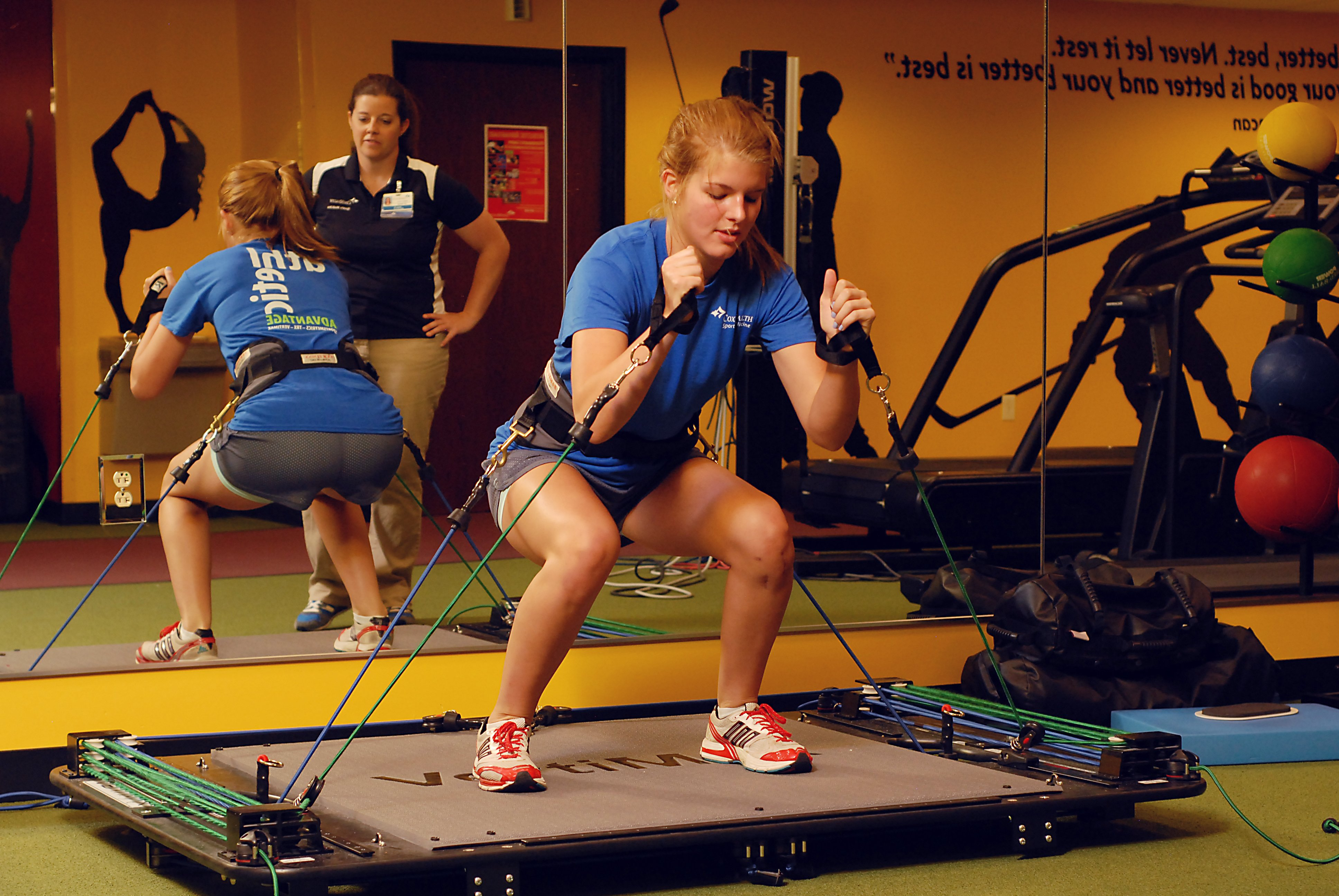 A woman exercising with CoxHealth's sports medicine therapy specialists.