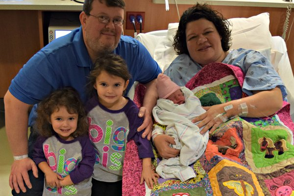 Family picture of the first newborn baby girl of 2017.