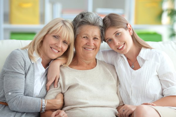 Group of three women posing for a picture