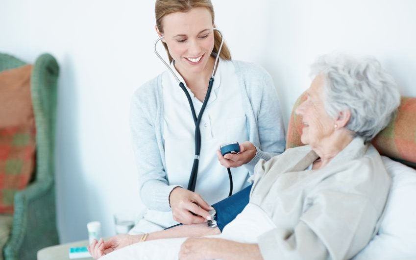 A CoxHealth doctor happily interacts with an elder patient.