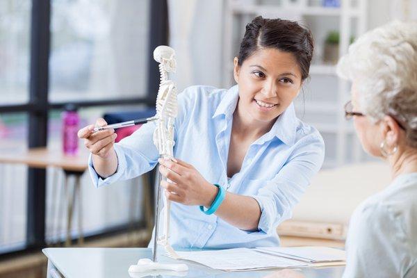 A provider educates a patient about bone health.
