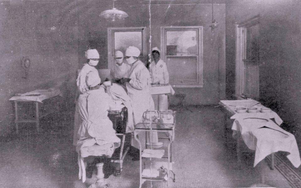 A historic photo of a surgery taking place circa 1930