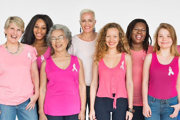 A group of women wears pink shirts.