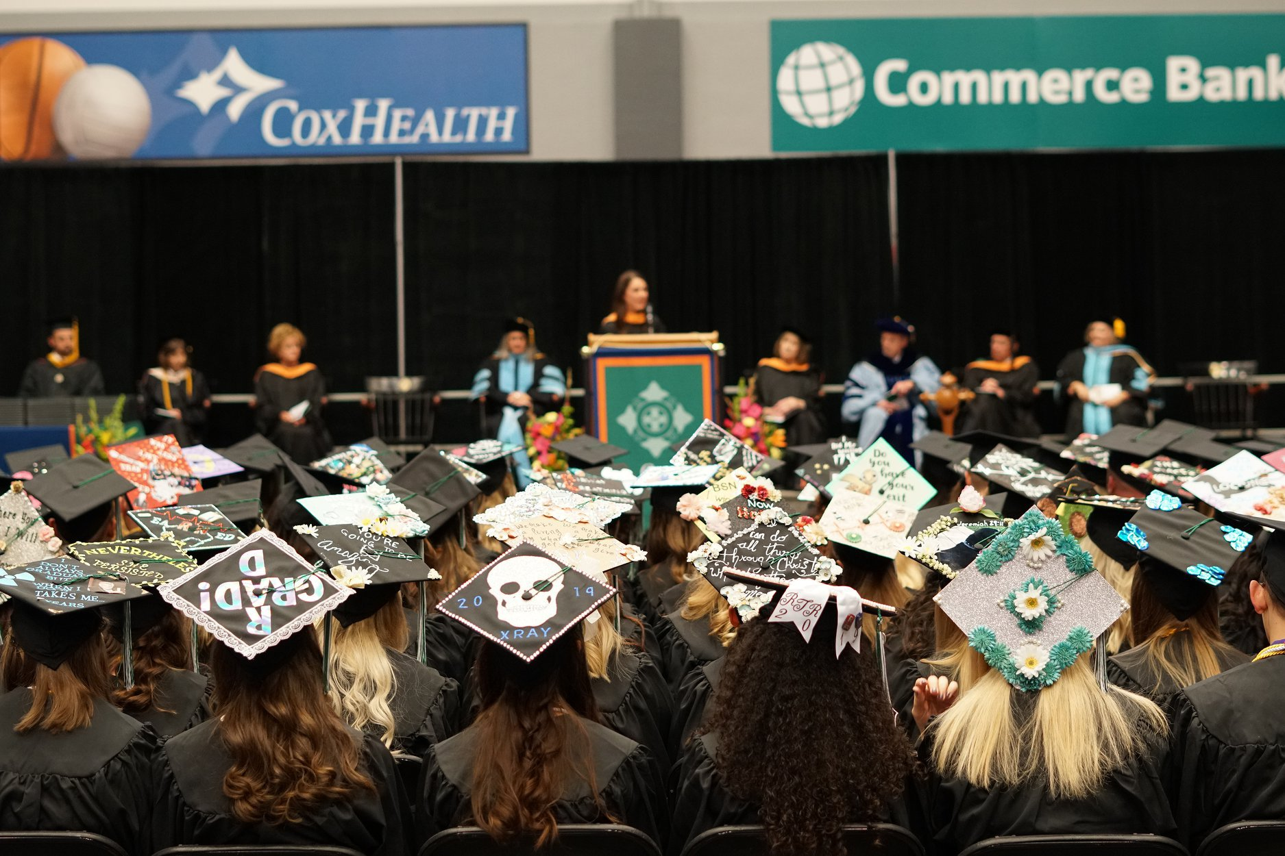 Students sit at Cox College's graduation.