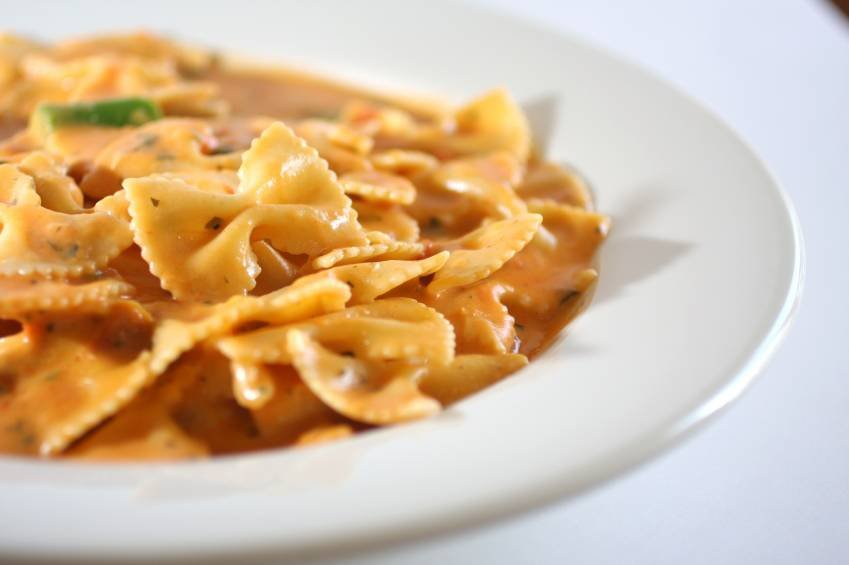 A bowl is filled with pasta.