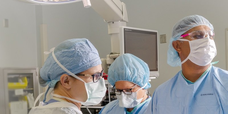 A trio of CoxHealth physicians operate on a patient.