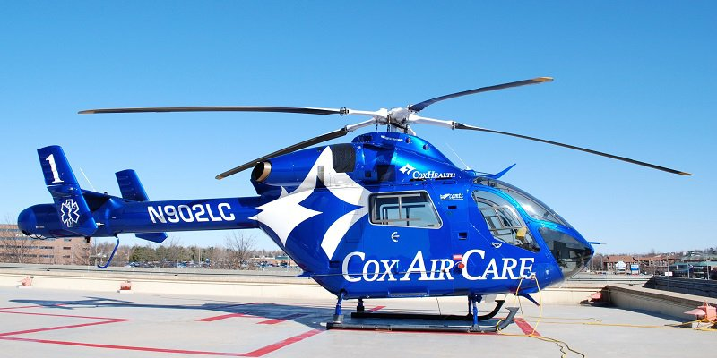 Cox Air Care helicopter on the landing pad.