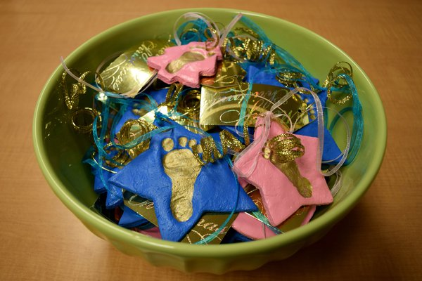 A bowl filled with NICU ornaments.