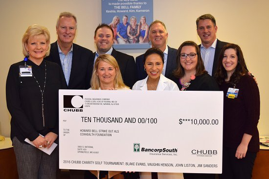 Group of cox health employees stand with a large check