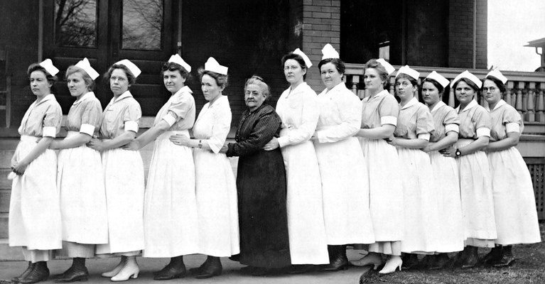Nurses from Burge hospital pictured with a patient in the 1950's.