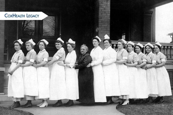 Ellen Burge, center, stands with a group of nurses.
