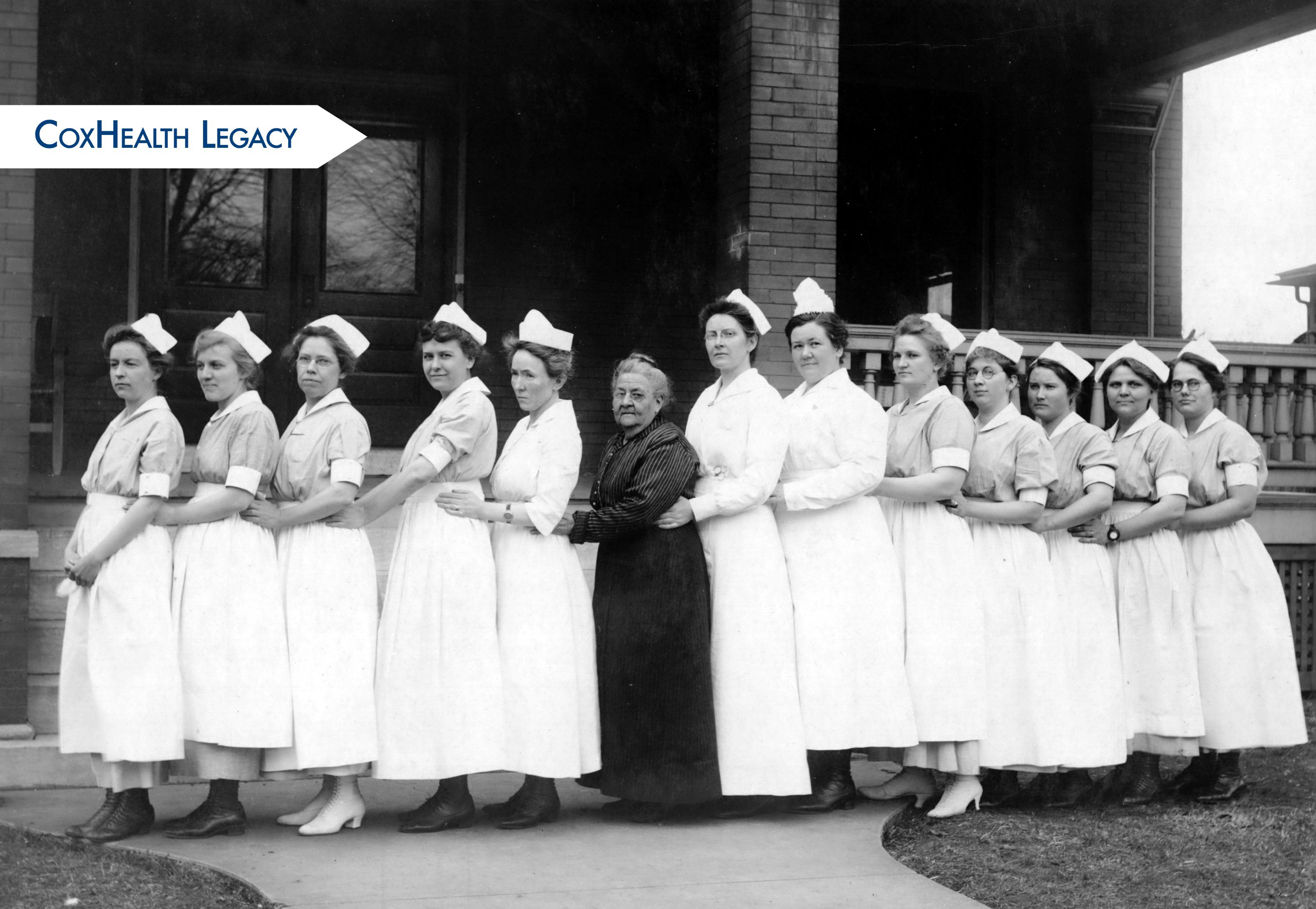 Ellen Burge, center, stands with a group of nurses.
