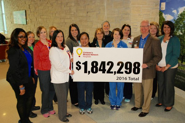 Group holds up total raised for Children's Miracle Network.