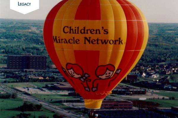 A Children's Miracle Network Hospitals hot-air balloon flies above Springfield.