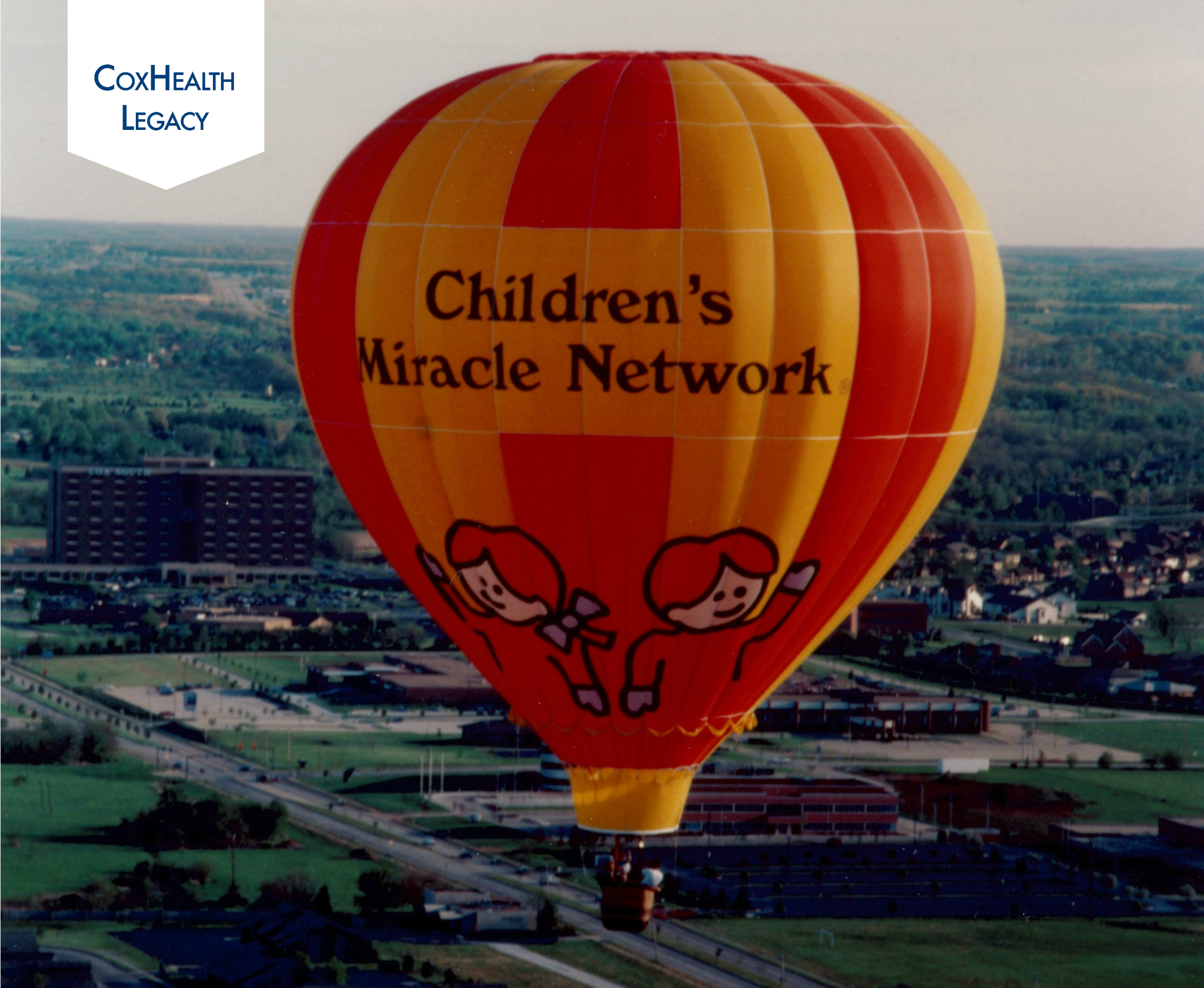 A Children's Miracle Network Hospitals hot-air balloon flies above Springfield.