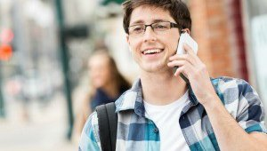 A young man is talking on his cell phone.