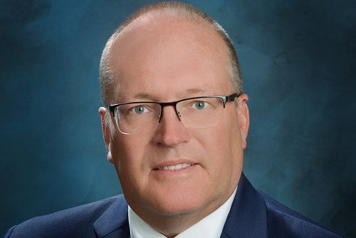A photograph shows Chuck Chalender, chair of the CoxHealth Board of Directors.