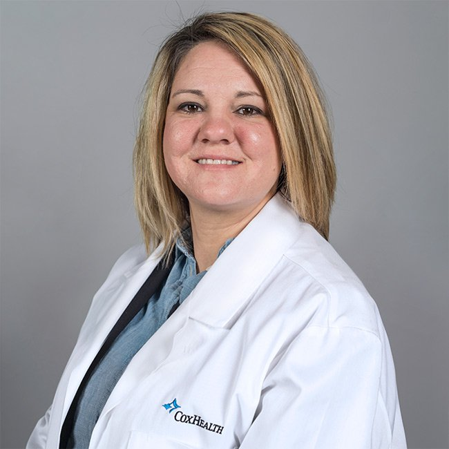 A photo shows Carla Clinton, a nurse practitioner with CoxHealth.