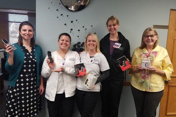 CoxHealth representatives drop off phones at The Victim Center.