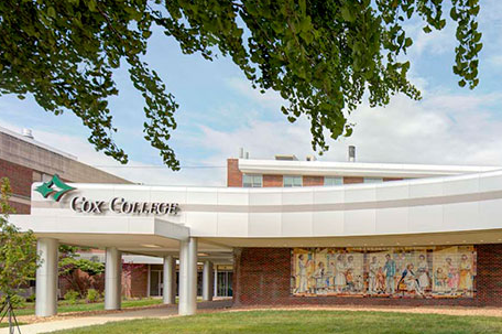 An image shows the front of Cox College.