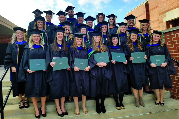 Cox College's first MSOT graduating class pose after the ceremony.