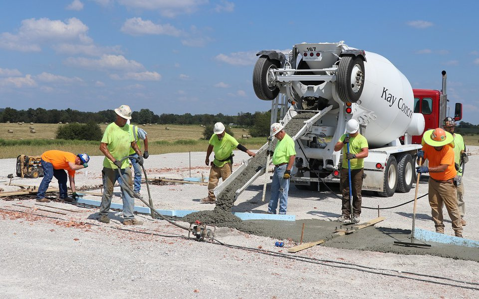 The crew begins pouring concrete, marking the official start of building the new hospital.