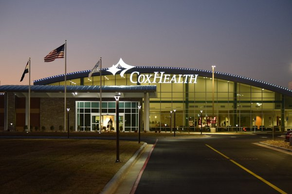 An image shows the front of the new Cox Monett Hospital.