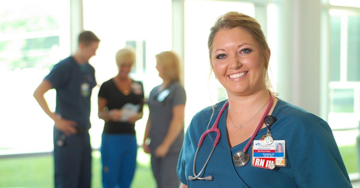 A nurse poses for a photo.
