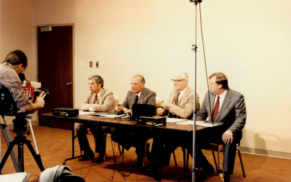 A historic photo of CoxHealth executives seated at a table at the Cox South grand opening