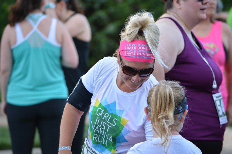 Women are shown at a recent Girls Just Wanna Run event.