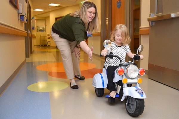 A Child Life specialist works with a child in the hospital.