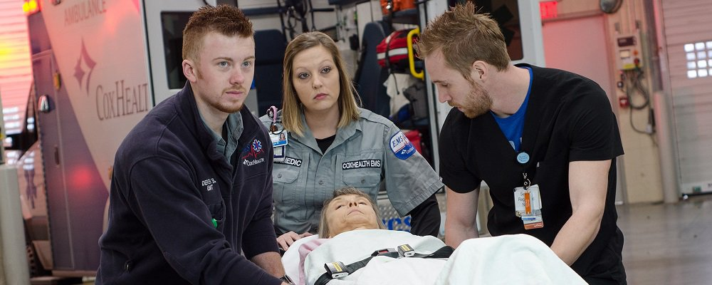 Three trauma CoxHealth employees working to save patients.