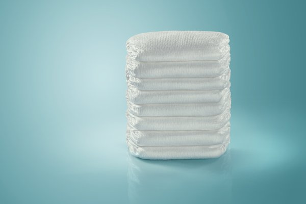 An image shows a stack of diapers.