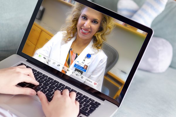 Patient video chatting with their doctor on the computer