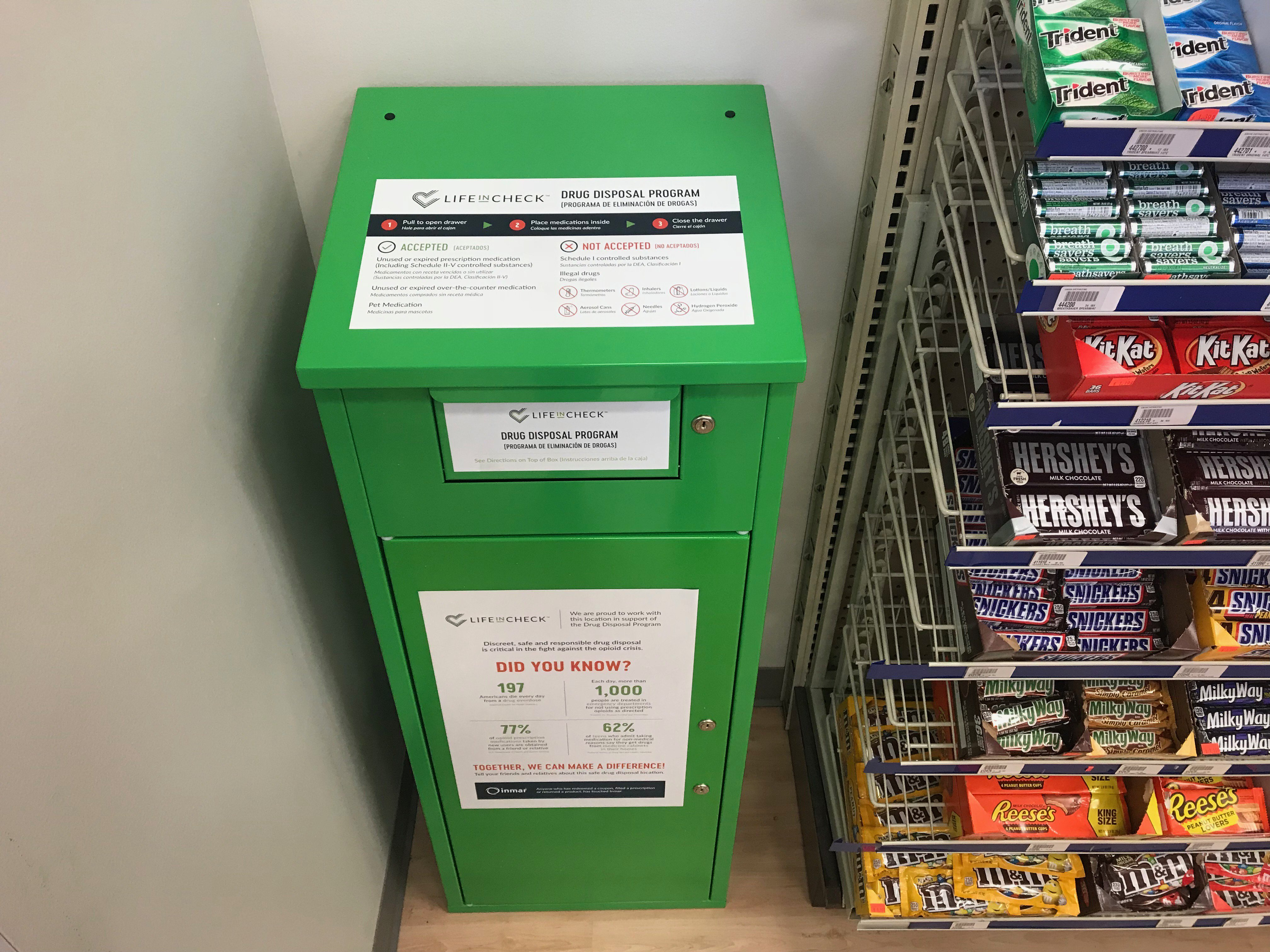 A drug take-back box is shown in a CoxHealth pharmacy.