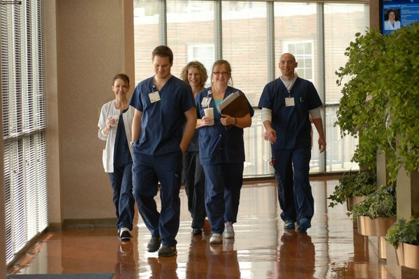 A group of employees walks down the hallway.