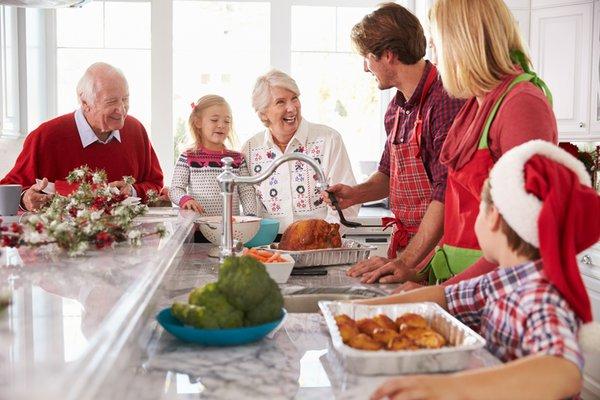 Family in the kitchen enjoying a festive dinner