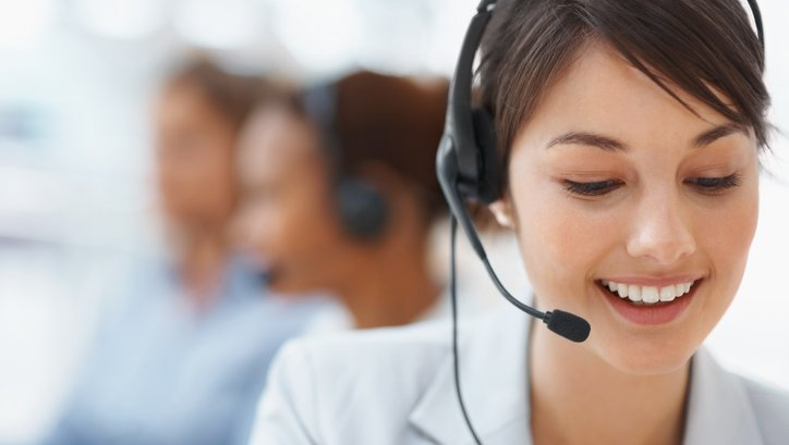 Phone support specialist talks on headset
