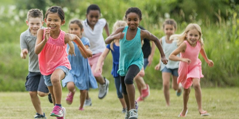 Children exercise in a field in CoxHealth's Cardiac Kids program.
