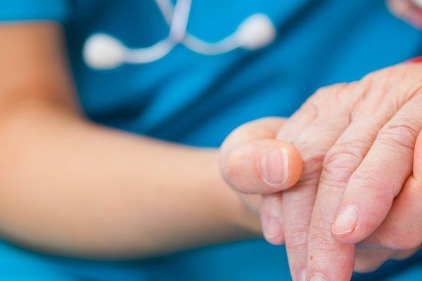 A nurse comforts a patient.