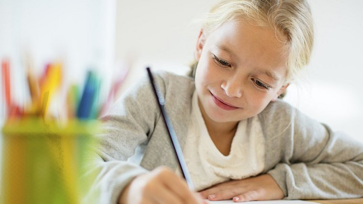 A CoxHealth pediatric hospital patient draws with colored pencils.