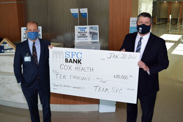 An image shows a check presentation from SFC Bank.