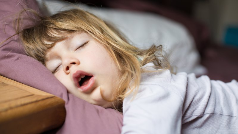 A young girl enjoys a deep and healthy sleep.