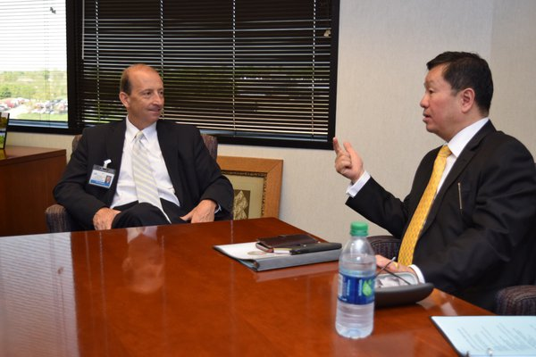 MU President talks with Cox Health leaders.
