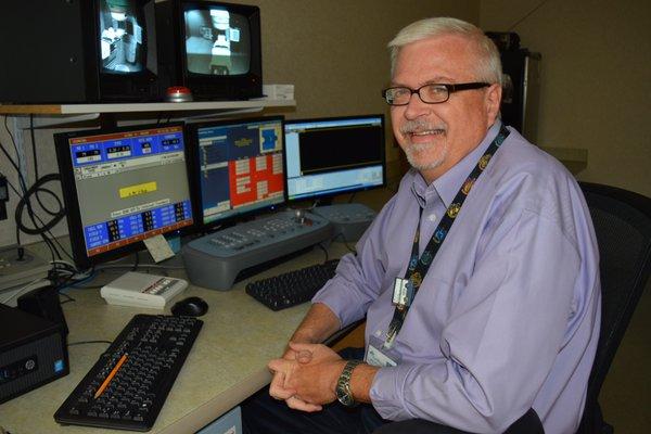 Randall Moore sits at his desk.