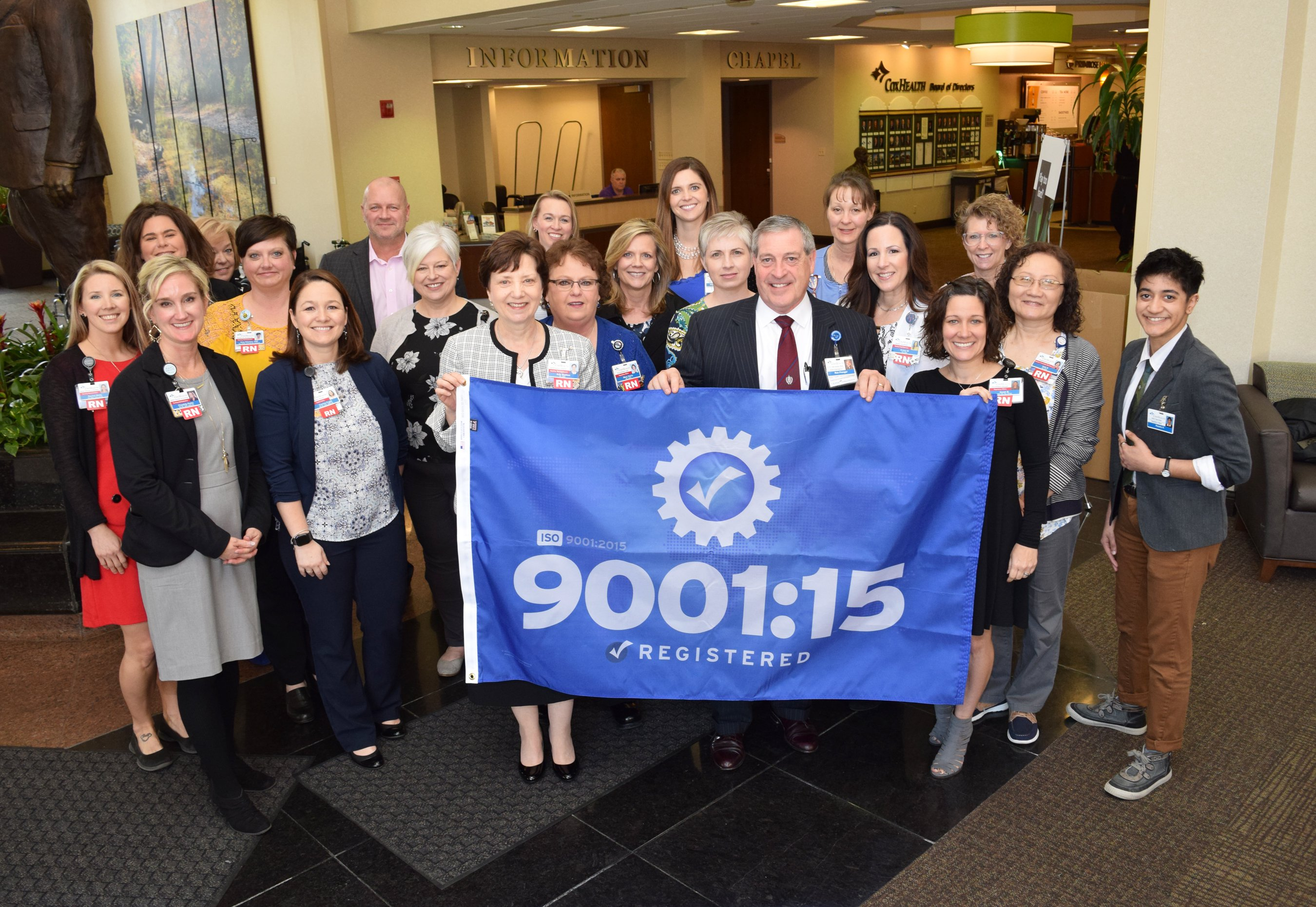 CoxHealth leaders and employees gather to hoist the ISO 9001 flag that now flies at Cox South.
