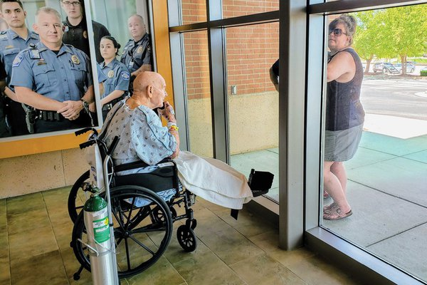A patient does a window visit with family