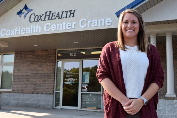Lydia Reinhold standing outside her new clinic